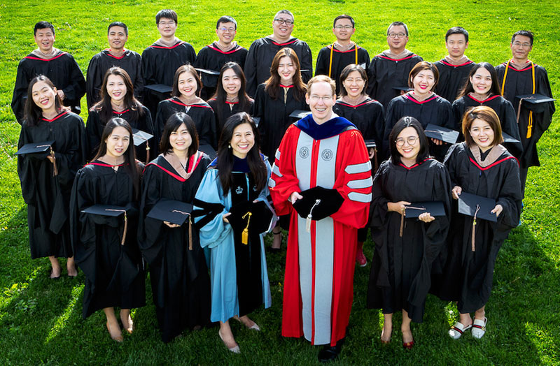 Photo of Cornell-Tsinghua graduates outside during Commencement in 2018