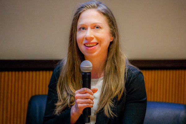 Chelsea Clinton holding a microphone
