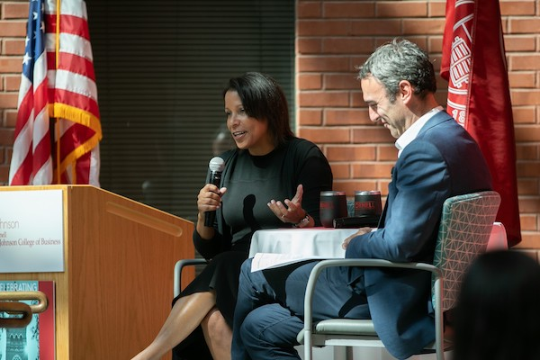 Angela and Drew on stage at the JWiB symposium
