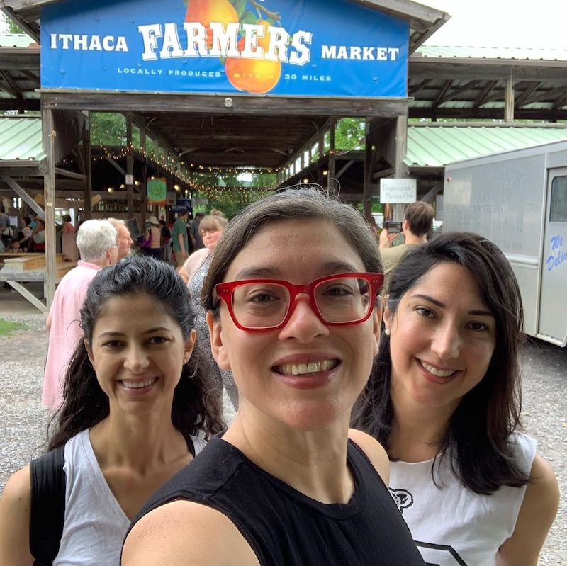 Three students take a selfie at the Ithaca Farmer's Market