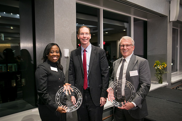 pictured left to right: Marmeline Petion-Midy '95, MBA '00, Dean Mark Nelson, and Larry Ruff, MBA '82