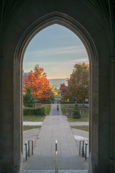 Cornell quad shown through an open walkway