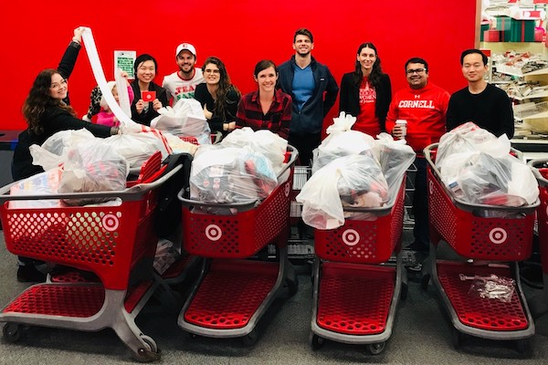 People standing with receipts and shopping carts at Target