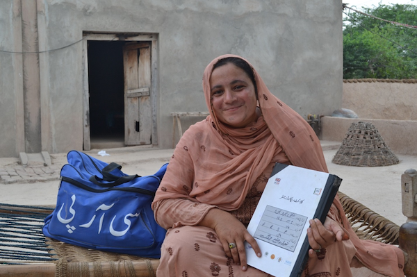 A community resource person in Pakistan, with her bag of products.