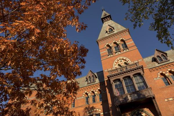 Sage Hall with autumn leaves and blue skies