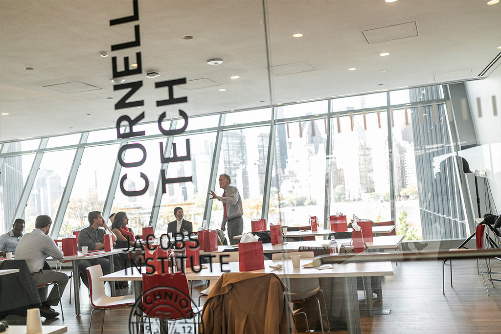 Students gathering in conversation at Cornell Tech