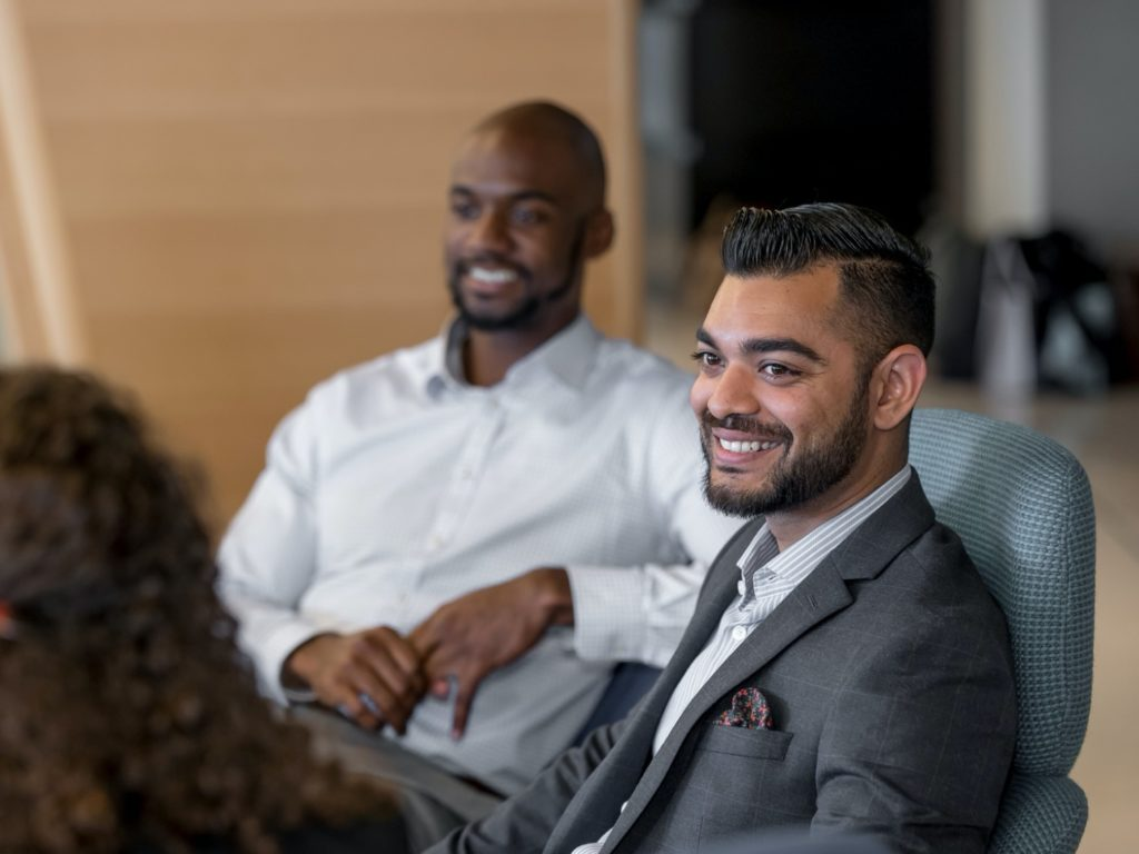 Two Johnson management students smiling.