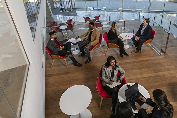 Overhead photo of EMBA/MS students sitting in a lounge