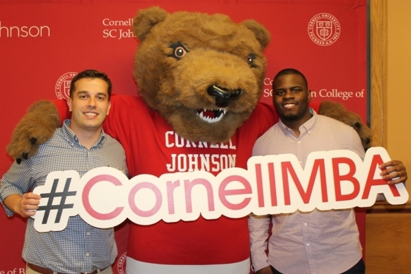 Cornell MBA students with Touchdown the bear
