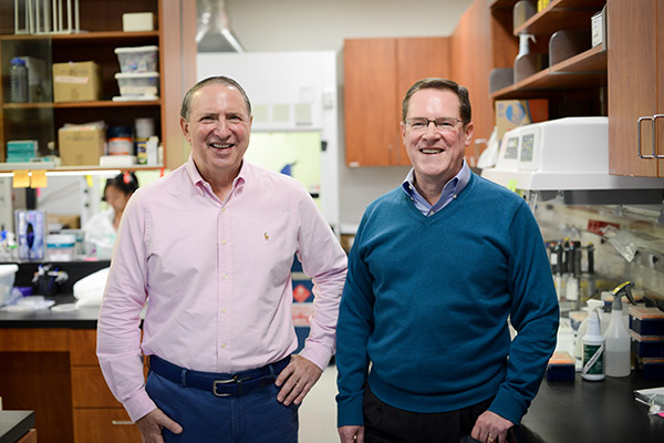 Tim Brown and Sandy Argabrite in the lab at Evolve Biosystems