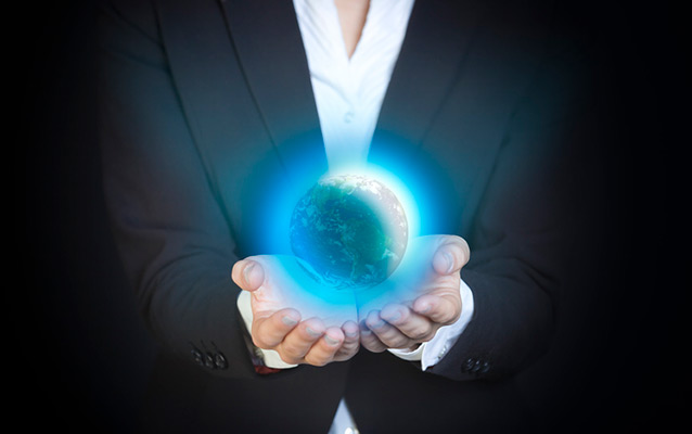 Globe in the hands of a businesswoman