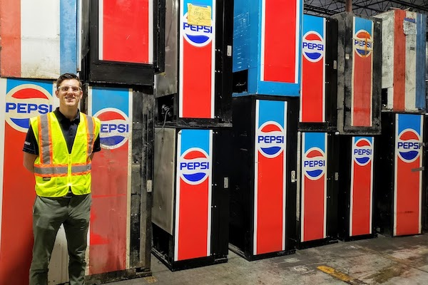 Taylor stands in front of old PepsiCo equipment