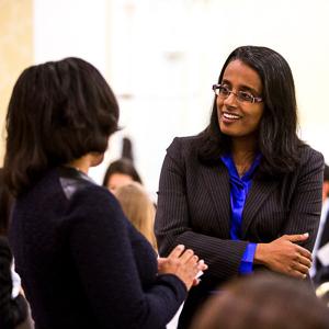 Lakshmi and a student talking