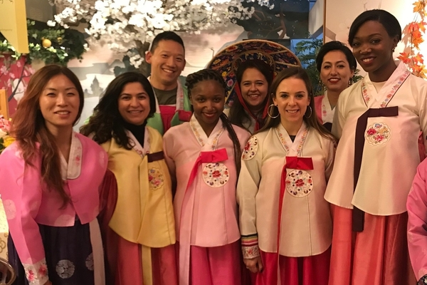 Students pose in traditional Korean 'hanbok' formal attire