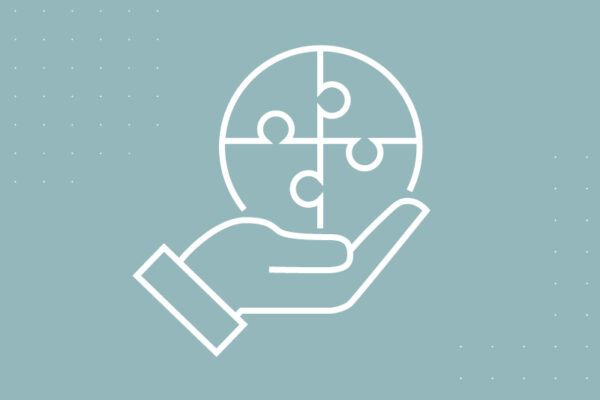 Icon of a hand holding a puzzle piece