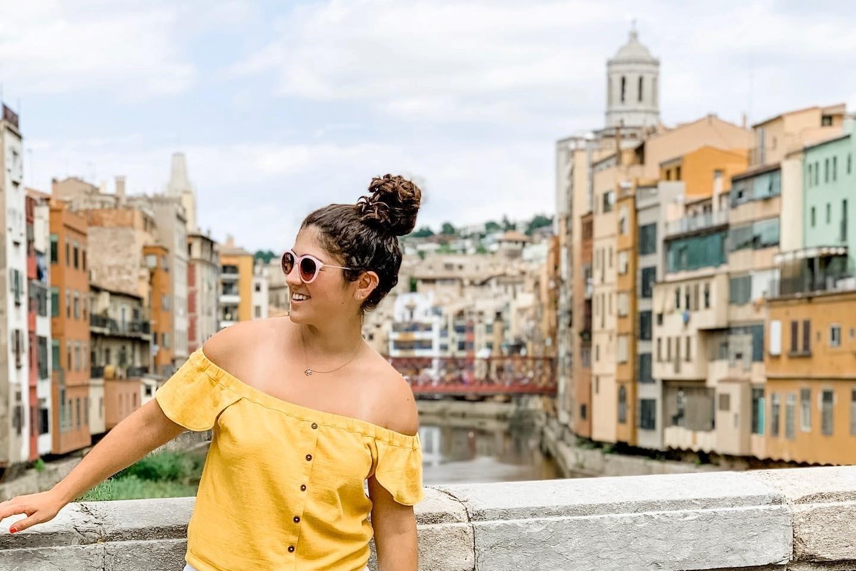 The author poses on a bridge while touring an European city.