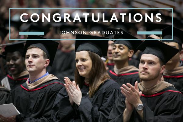 Photo of seated graduates that says Congratulations Johnson graduates