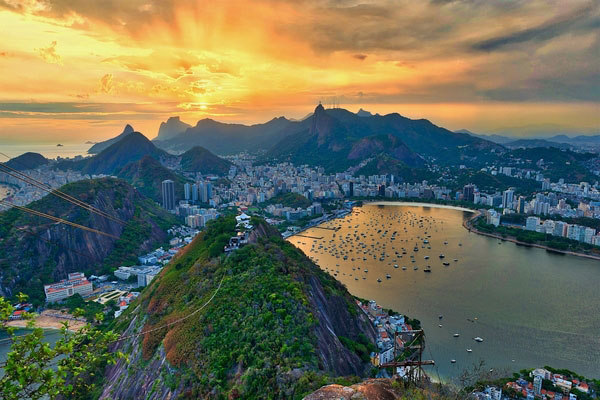 Aerial photo of the city of Rio de Janeiro, Brazil, with mountains and coastline in the distance