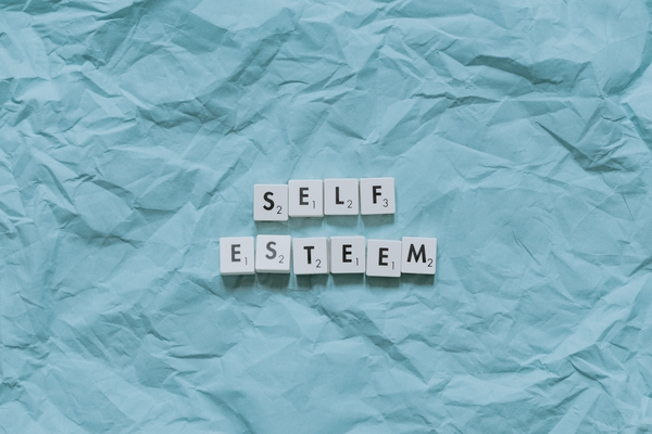 the words self esteem unwrapped in paper